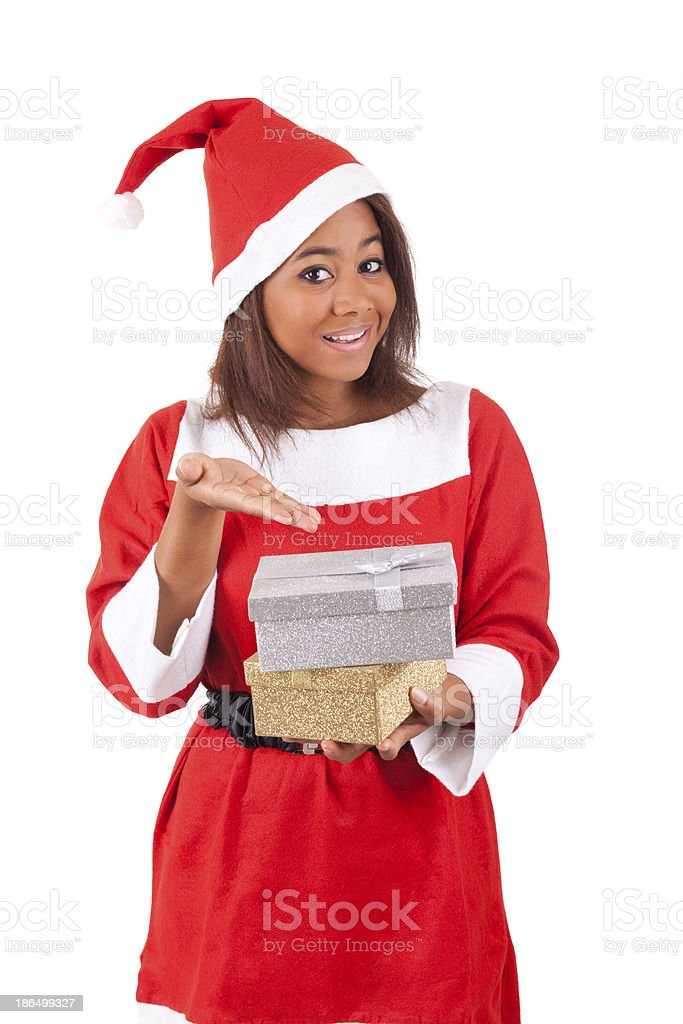 Young african american woman with  santa hat and gifts royalty-free stock photo