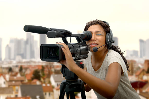 young African American women with professional video camera stock photo