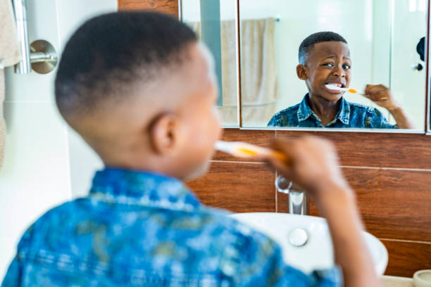 Young African Boy Brushing His Teeth stock photo