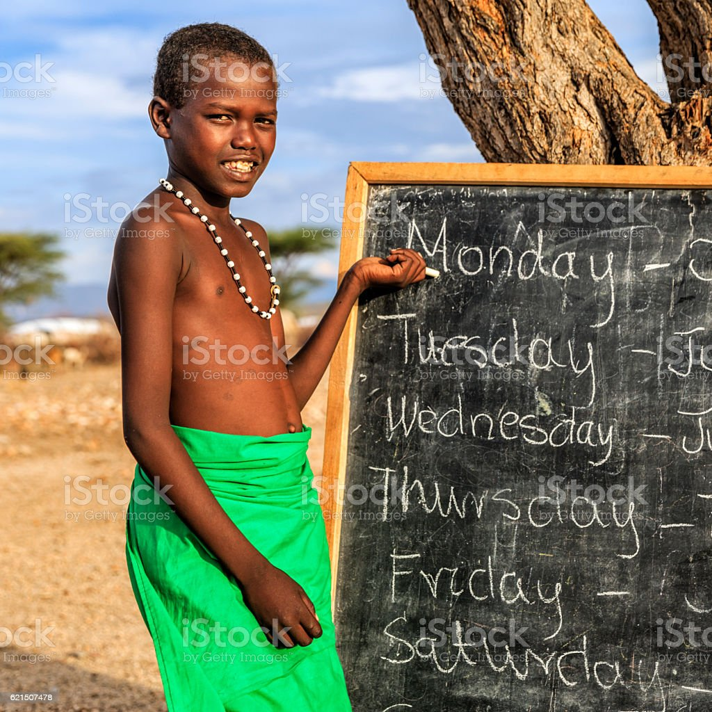 Young African boy during English class, East Africa foto stock royalty-free