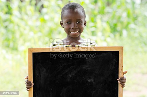 istock Young African Boy Holding Blackboard Outdoors for a Communication Symbol 492483540