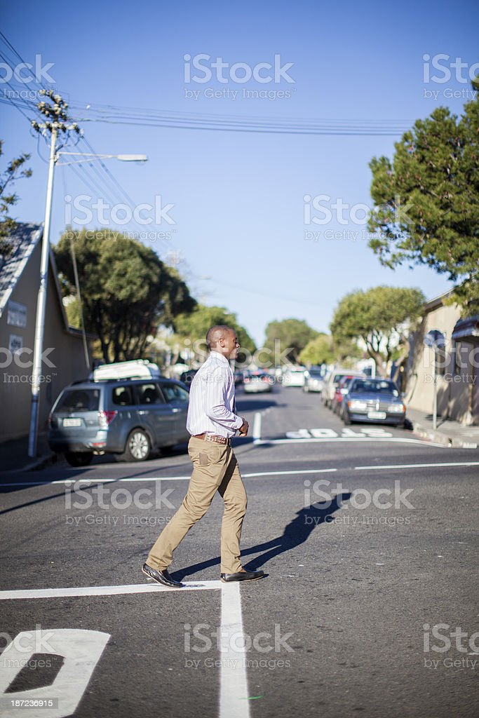 Young African Businessman crossing the street, Cape Town royalty-free stock photo