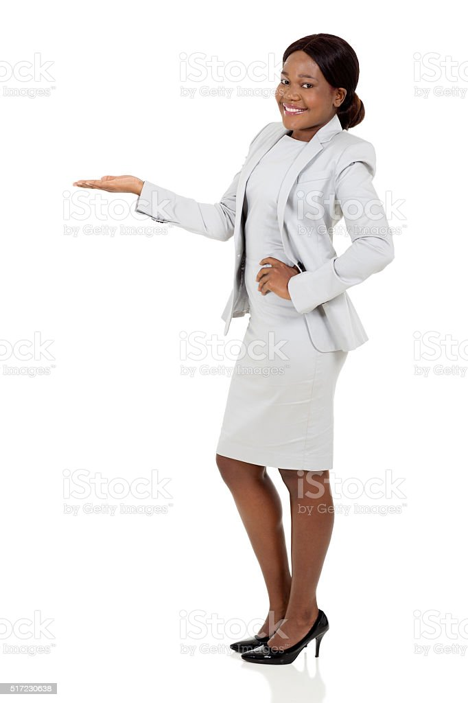 young african businesswoman presenting stock photo