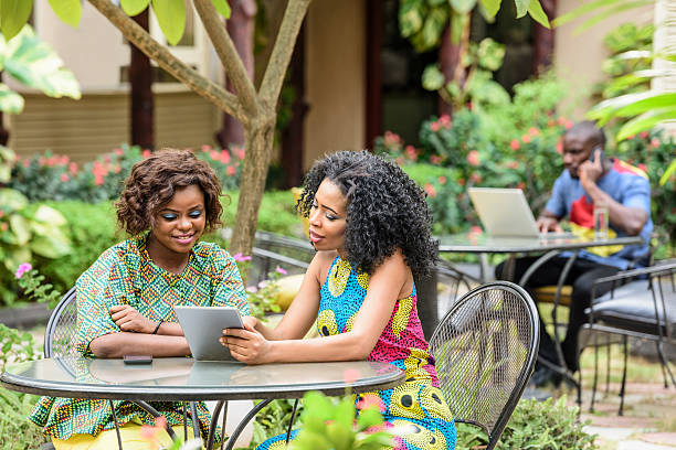 Young African businesswomen using digital tablet stock photo