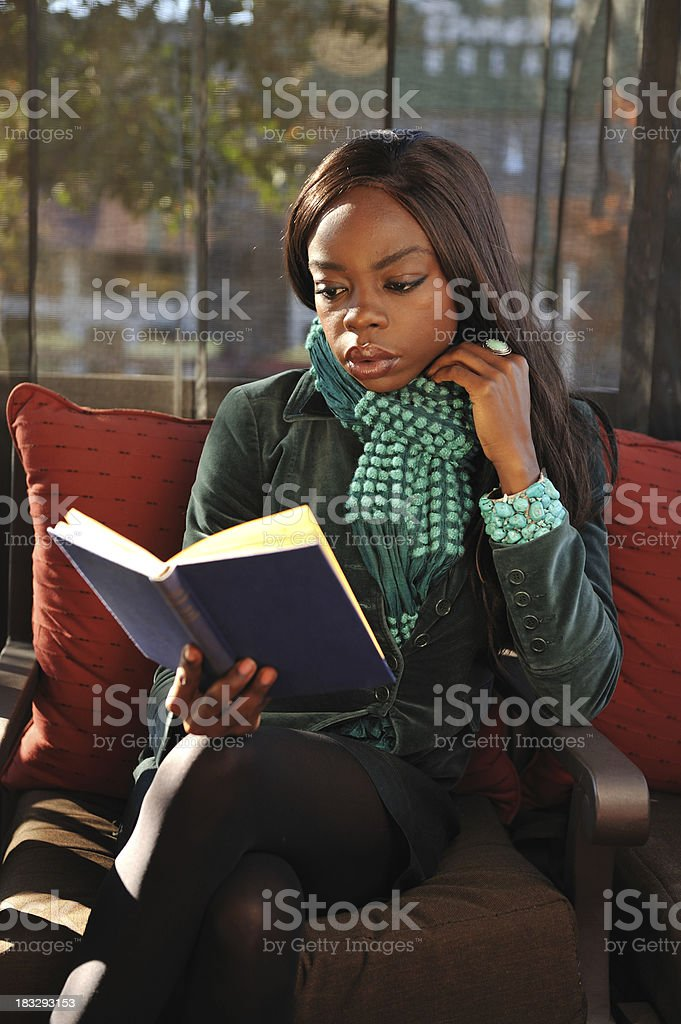Young African college student reading a book stock photo