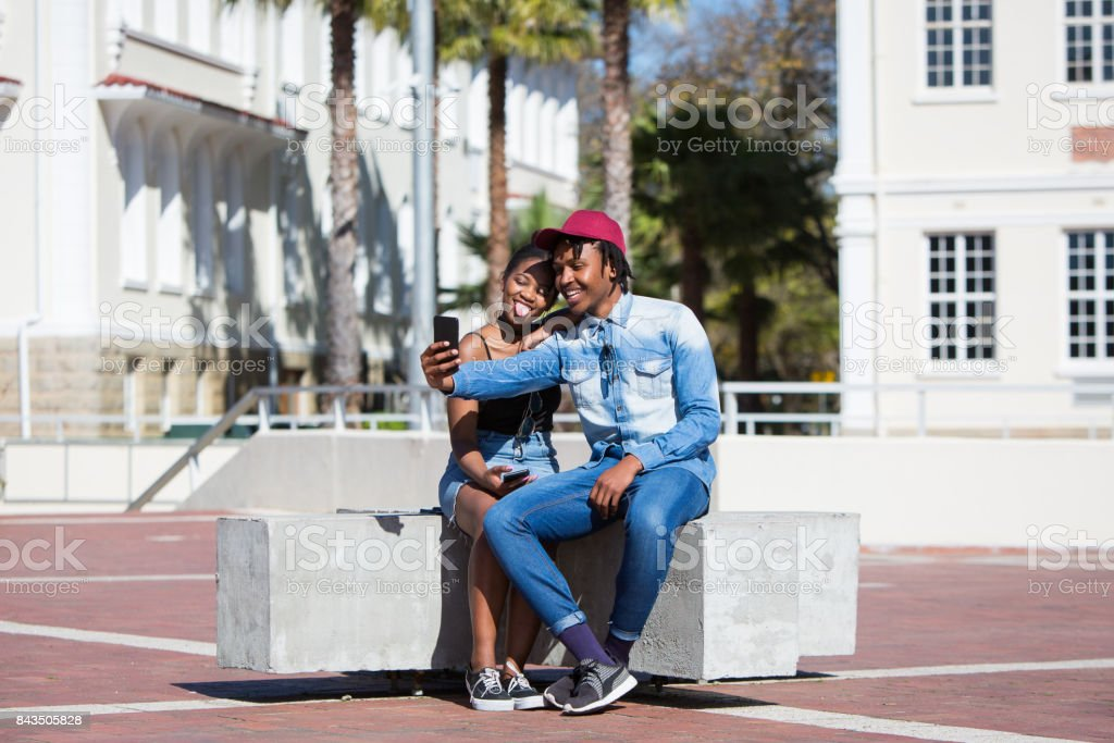 Young African couple taking a selfie picture stock photo