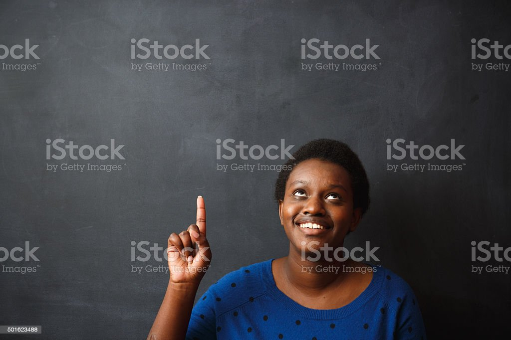 Young african descent woman thinking stock photo