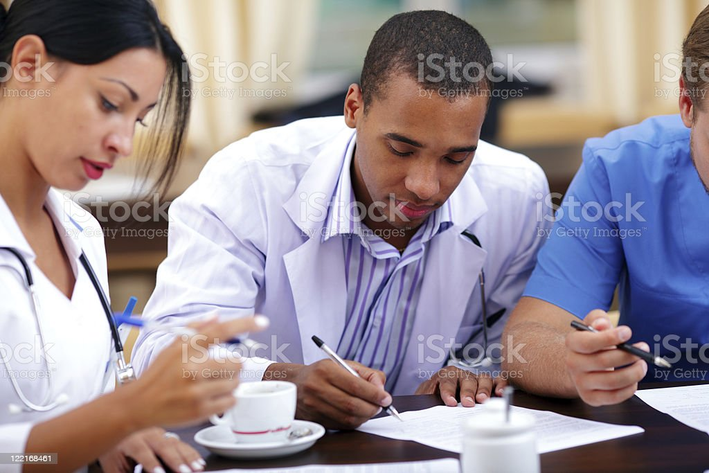 Young african doctor making notes stock photo