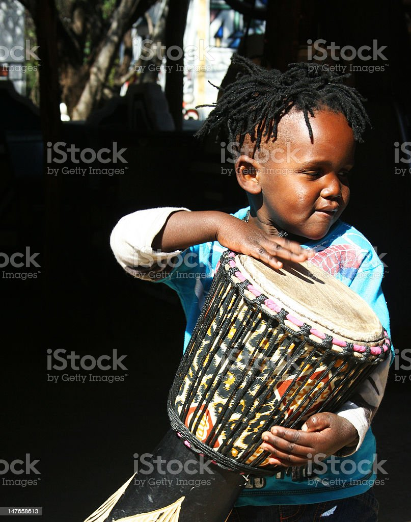 Young African drummer boy stock photo