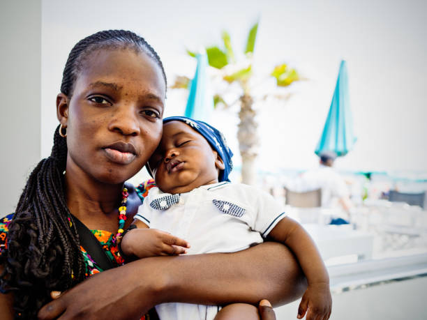Young African emigrant mother with baby stock photo