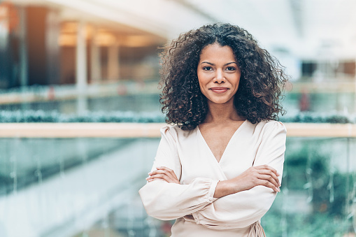Businesswoman with arms crossed looking at camera