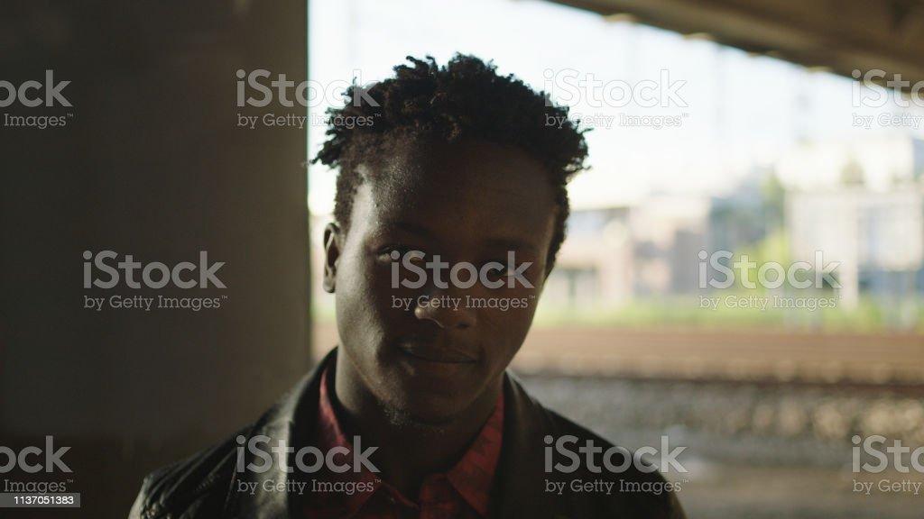 Contemplative man posing in industrial area.