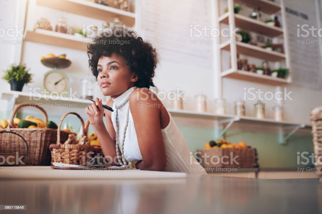 Young african female juice bar owner stock photo