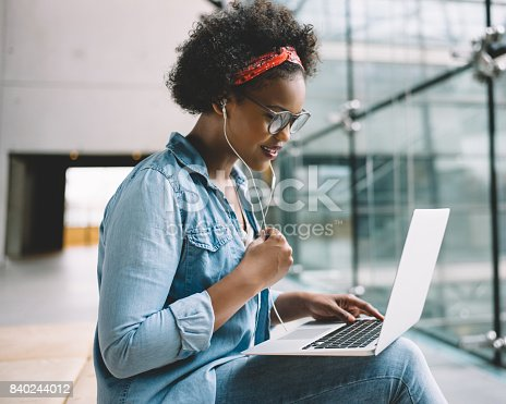 istock Young African female student working on a laptop on campus 840244012