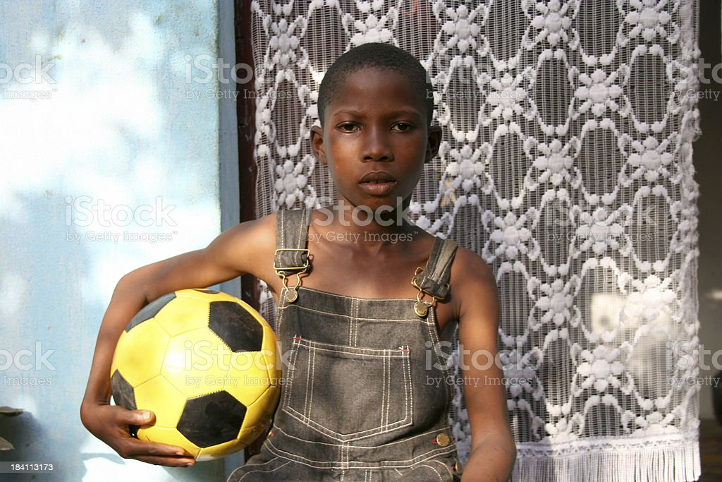 young african footballer stock photo