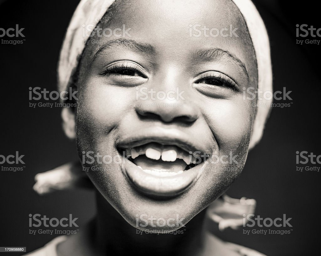 Young African Girl Laughing (Isolated on Black) stock photo