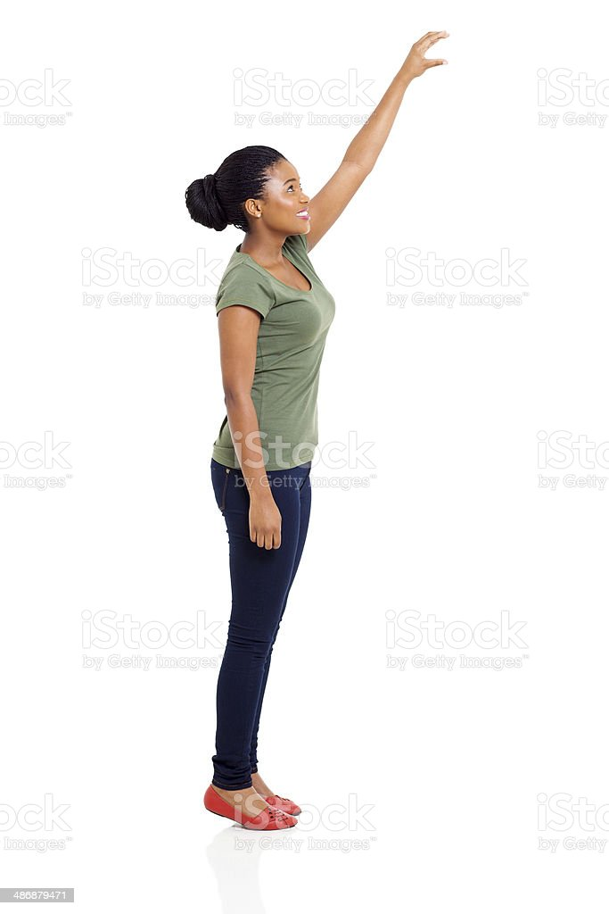 young african girl reaching something high stock photo