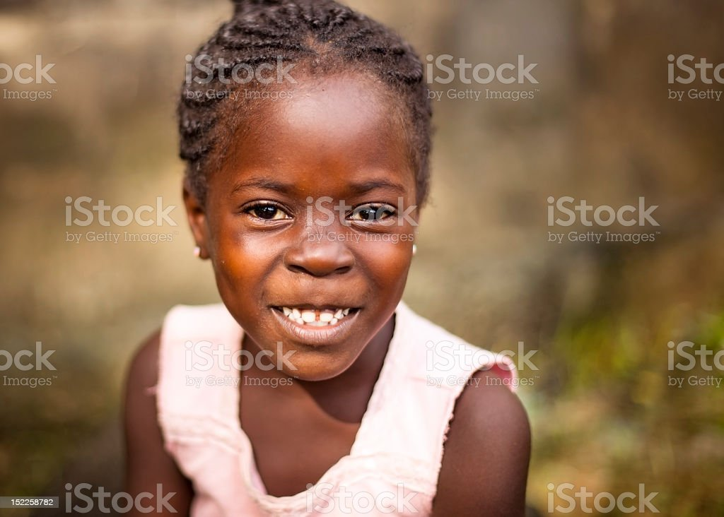 young african girl smiling stock photo