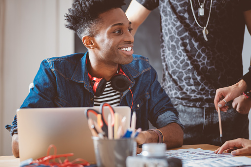 918746260 istock photo Young african guy in meeting with creative team 667025070