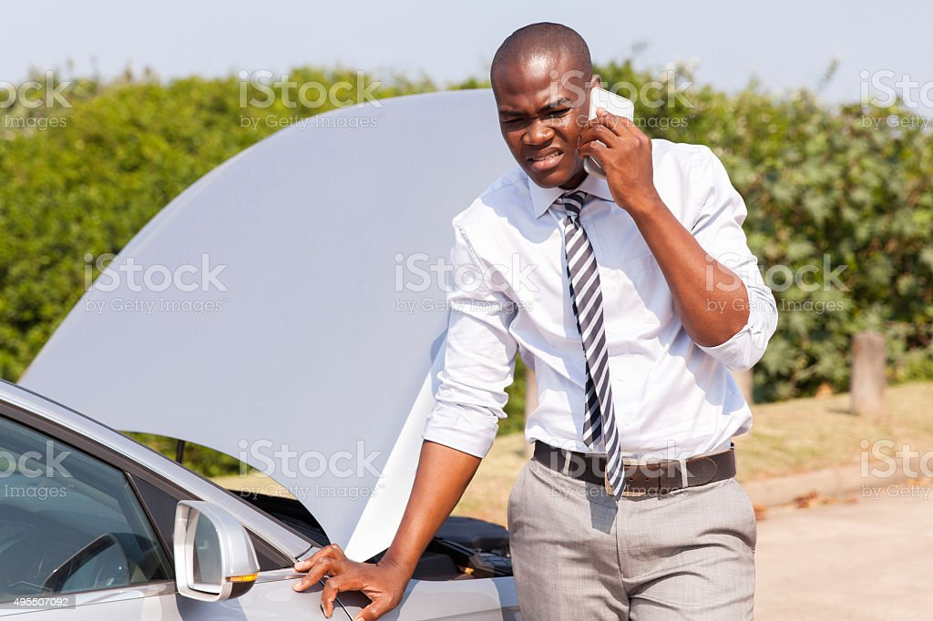 young african man calling for assistance stock photo