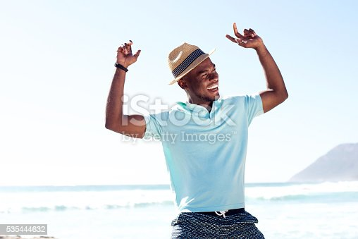 istock Young african man having fun at the beach 535444632