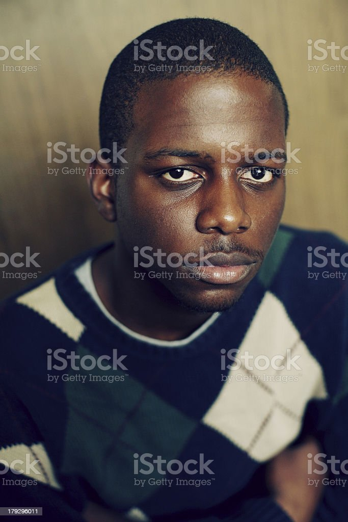 Young African Man in Argyle Sweater royalty-free stock photo