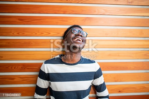 Portrait of a young African man laughing