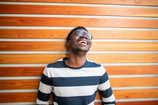 Young African man laughing. Portrait of a young African man laughing only young men stock pictures, royalty-free photos & images