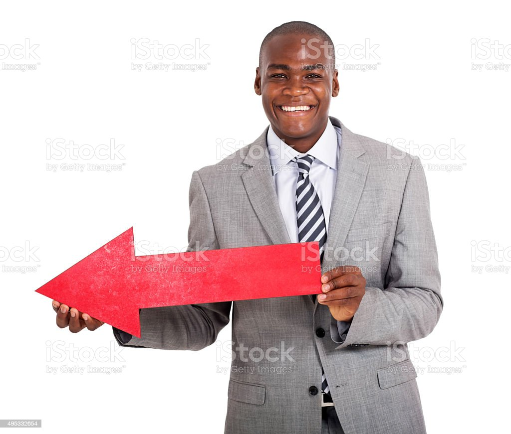 young african man with direction arrow sign stock photo
