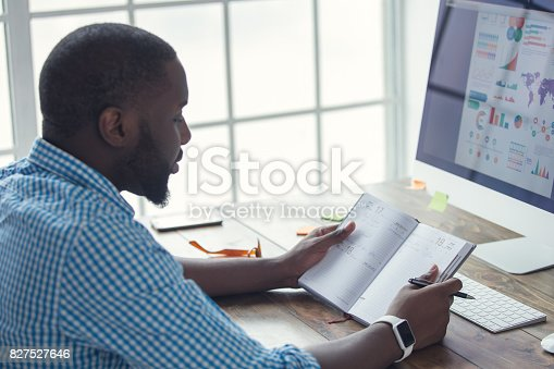 istock Young african man working in the office business 827527646
