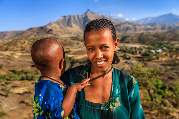 Young African mother holding her baby, East Africa stock photo