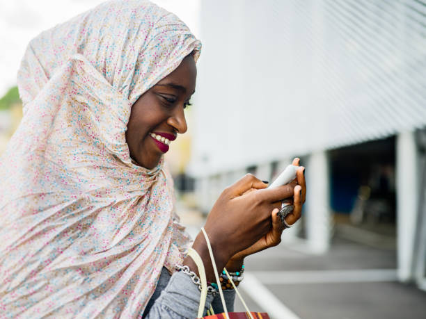 Young African Muslim Woman with shopping bags stock photo