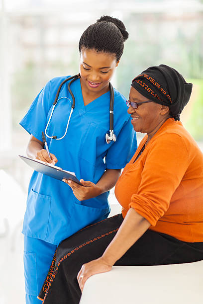 young african nurse explaining medical test result stock photo