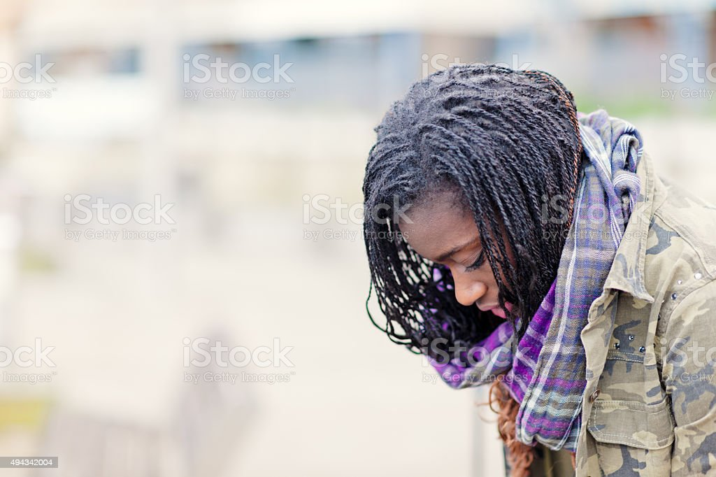Young African pensive woman stock photo