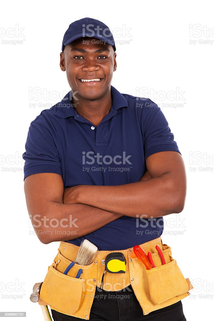 young african repairman looking at the camera stock photo