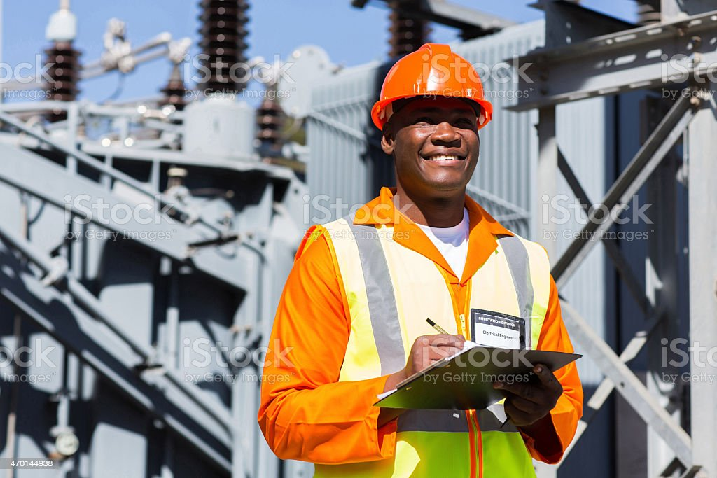 young african technician working in substation stock photo