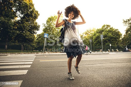 Young african teenager dancing in the city streets