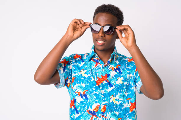 Young African tourist man with Afro hair wearing sunglasses stock photo