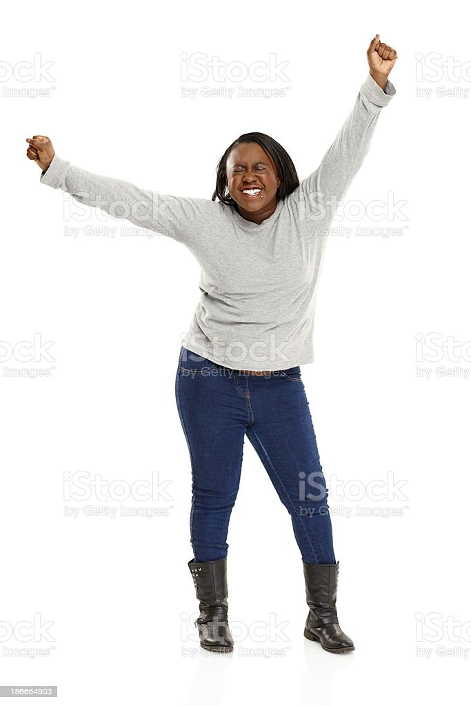 Young african woman celebrating success on white royalty-free stock photo