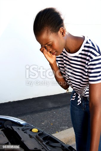 860373412 istock photo young african woman having trouble with her broken car calling for help on cell phone 944698456