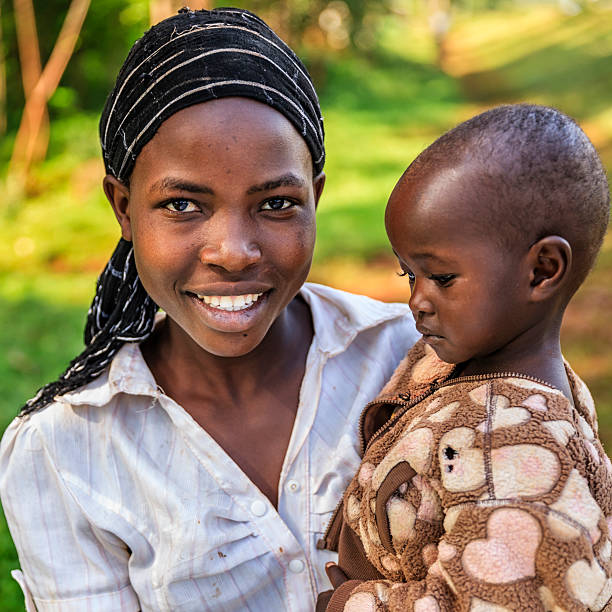 Young African woman holding her baby, Kenya, East Africa stock photo