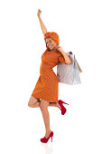 istock young african woman holding shopping bags 480956133