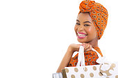 istock young african woman holding shopping bags 480959079