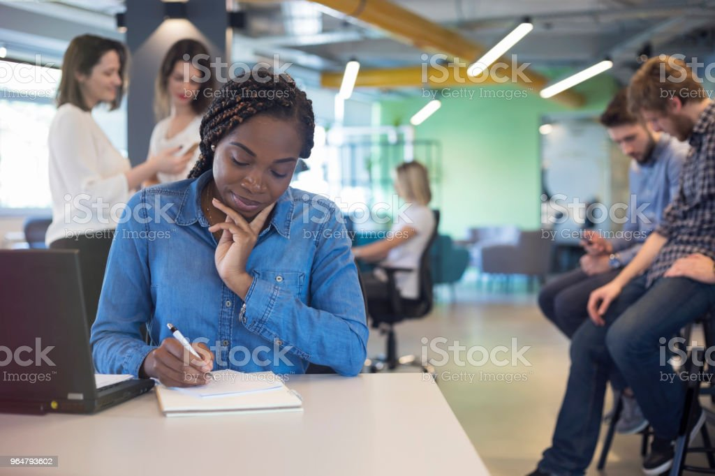 Young African woman in modern office royalty-free stock photo