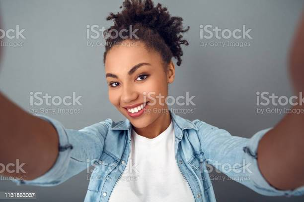 Young african woman isolated on grey wall studio casual daily selfie picture id1131863037?b=1&k=6&m=1131863037&s=612x612&h=7eiao8yct6g86g8k83hfjbk7zqqjunte5hmhcf5cqz4=