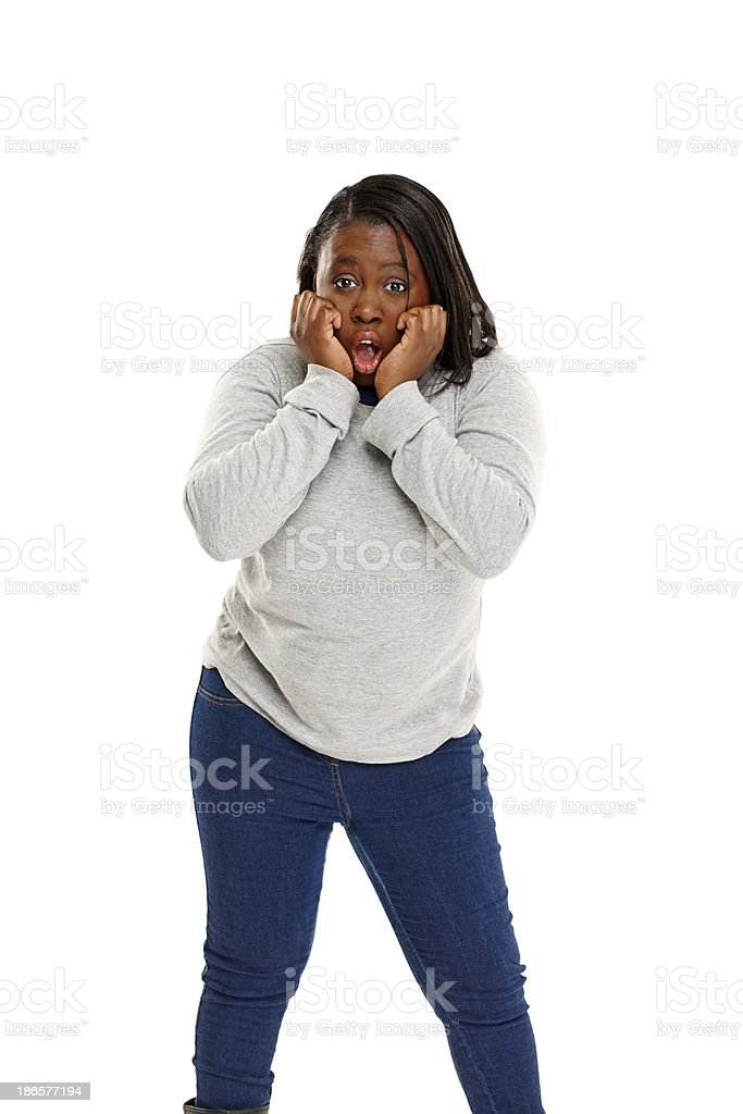 Young african woman looking scared royalty-free stock photo