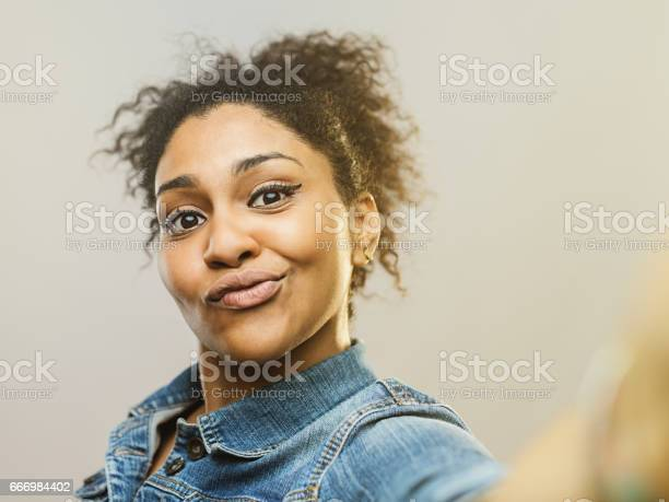 Young african woman making a funny face and taking selfie picture id666984402?b=1&k=6&m=666984402&s=612x612&h=xsrmne4v3jpo1jcdc0yjrolbukqfb3p4gcwaq5fmq y=