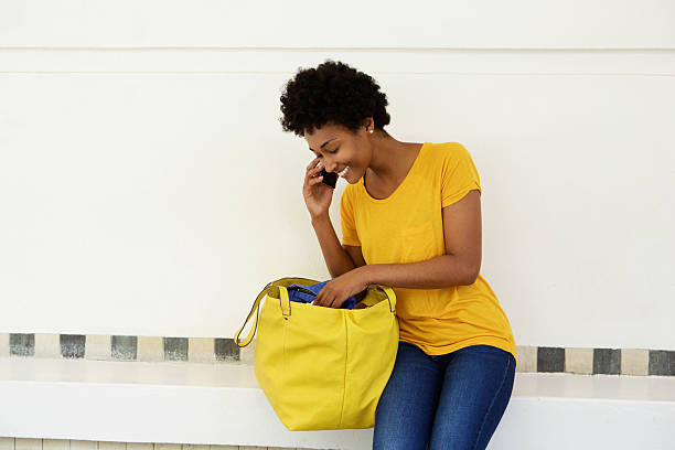 Young african woman making a phone call stock photo