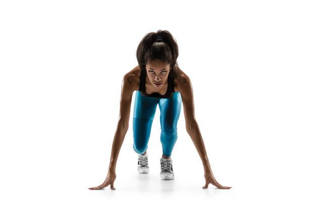 young african woman running or jogging isolated on white studio background. - corsa su pista femminile foto e immagini stock