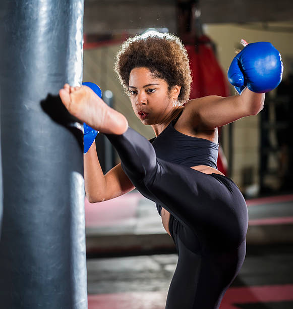 Young african woman training at gym, boxing stock photo